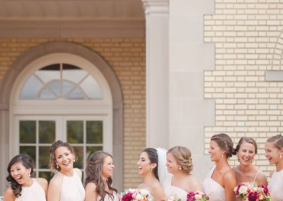 Bridesmaids in front of mansion